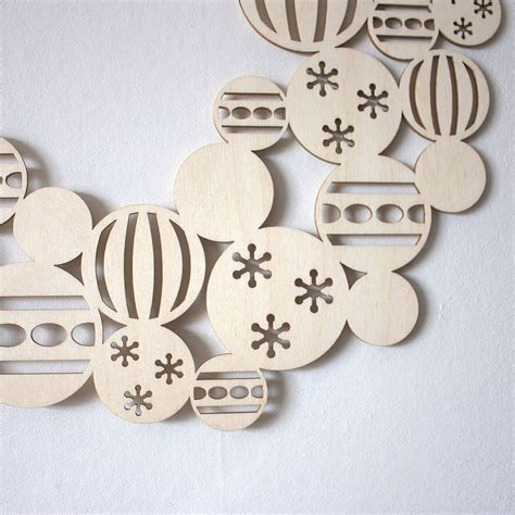 wooden decorations wooden bauble wreath by gilbert13