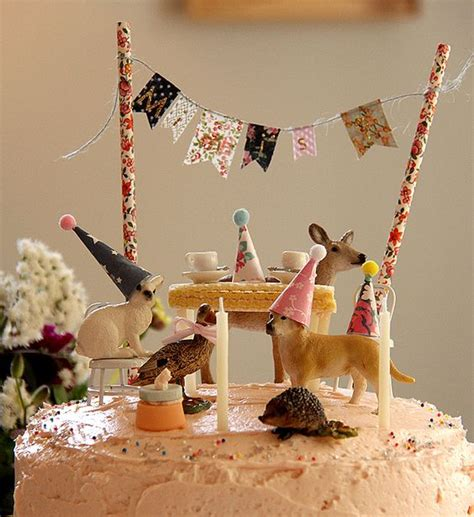 animal two boy and one adorable on top of the cake creatures with