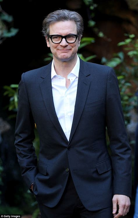 actor with thick rimmed glasses colin firth is joined by take that at kingsman the secret