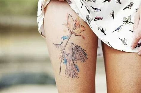 tattoo placement thigh upper thigh tattoo bird and flower tattoo placement