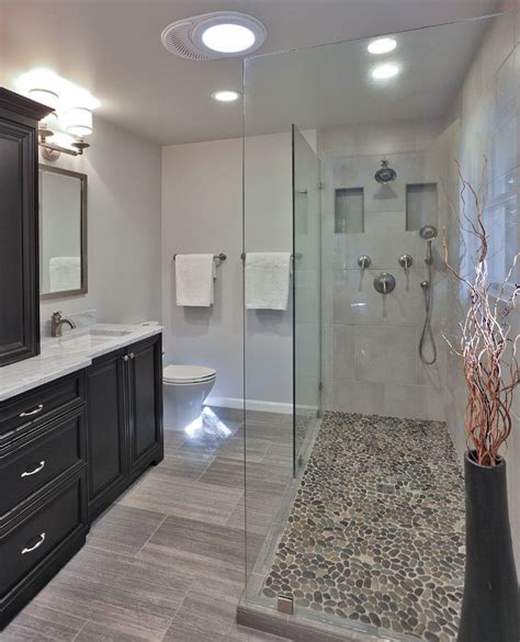 grey pebble tiles bathroom pebble shower floor bathroom transitional with bath