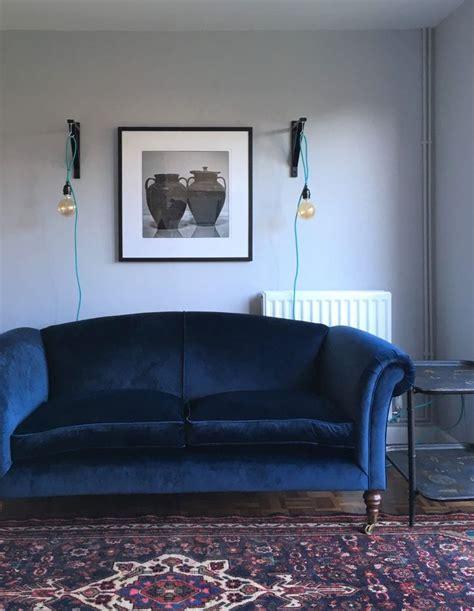 navy blue velvet sofa persian rug sitting room lounge