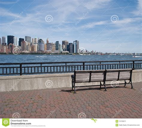 bench nyc park bench and view of new york city skyline stock image