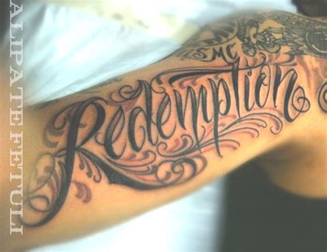 redemption tattoo redemption on bicep tattooshunt