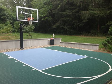 outdoor basketball court backyard half court with a hill