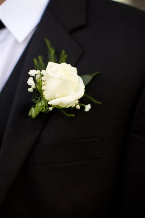 white rose  babys breath boutonniere