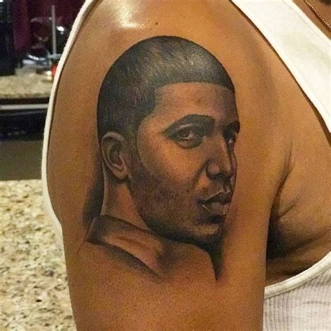 drakes tattoo dennis graham gets on his arm