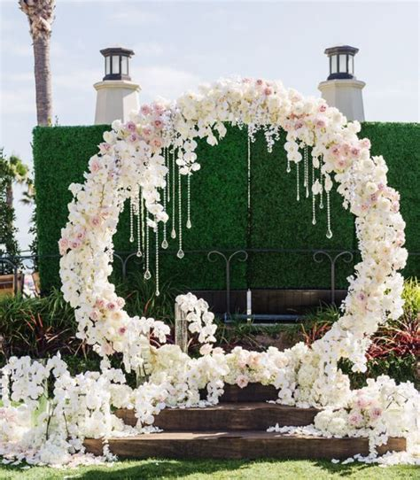 wedding arch circle picture of a luxurious circle floral arch with white and