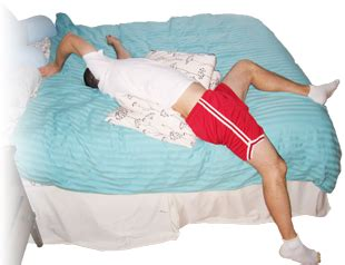 lower back stretches in bed low back pain stretching the quadratus lumborum muscle top leg drops off the edge of