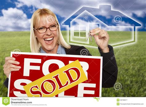 libro sold one womans true woman with sold for sale sign keys and ghosted house royalty free stock photography image