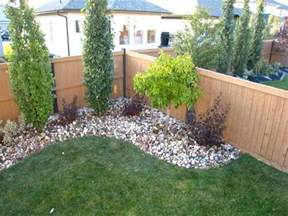 Dress up the corner of your yard with small trees shrubs if you need some landscaping done