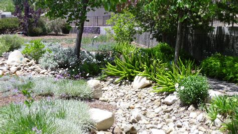 dry river bed landscape design a dry riverbed into your garden ehow home ehow