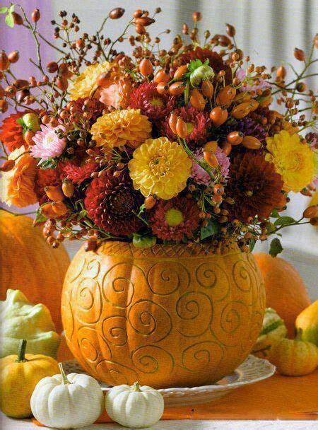 cute fall floral centerpiece idea garden mums  pumpkin