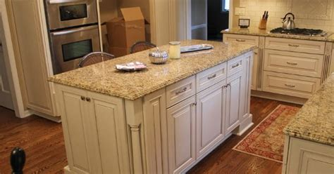 Biscotti kitchen cabinets with light granite countertops