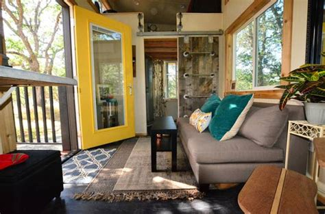 tall tiny house with a porch and loft hefty 224 sq ft little house doesn t feel tiny at all
