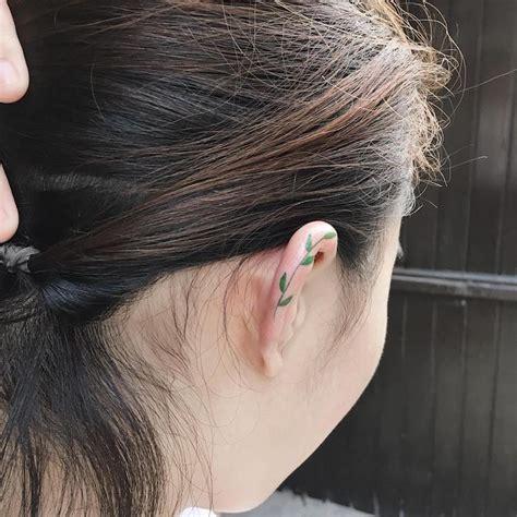 minimalist tattoo ear minimalist ear tattoo trend has people getting tiny