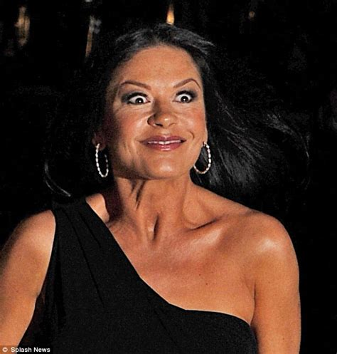 catherine zeta jones stuns  asymmetric black dress
