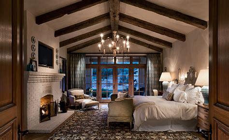 exposed wooden roof beams  bedroom