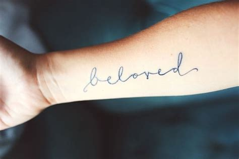 beloved words on forearm