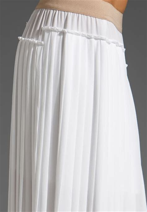 bcbgmaxazria pleated maxi skirt with slits in white lyst