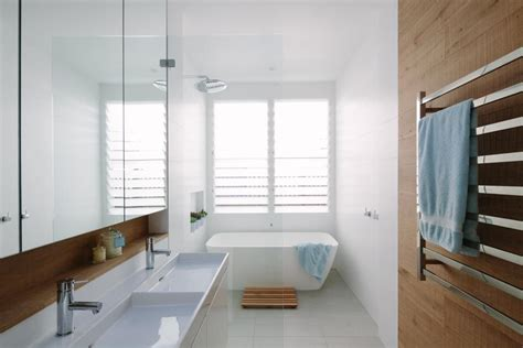 bathroom louvre windows willoughby residence celebrates light warmth texture