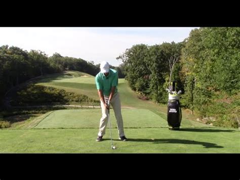 scooping golf swing golf swing hitting solid iron shots and compressing t doovi