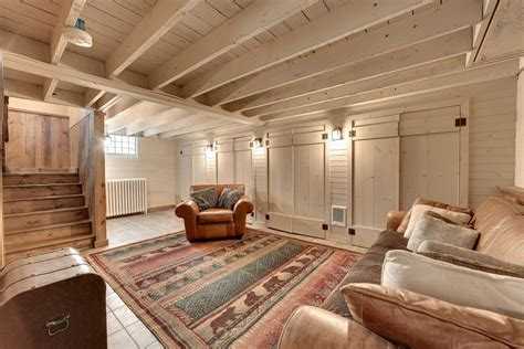 rustic basement with restoration hardware lancaster leather swivel chair exposed beam