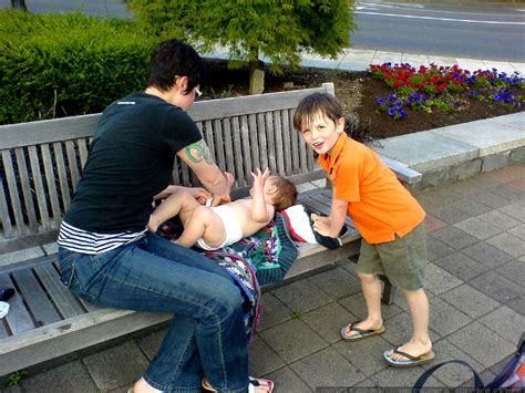 4 year old boy diaper change photo diaper change on the fountain bench dsc00998 by