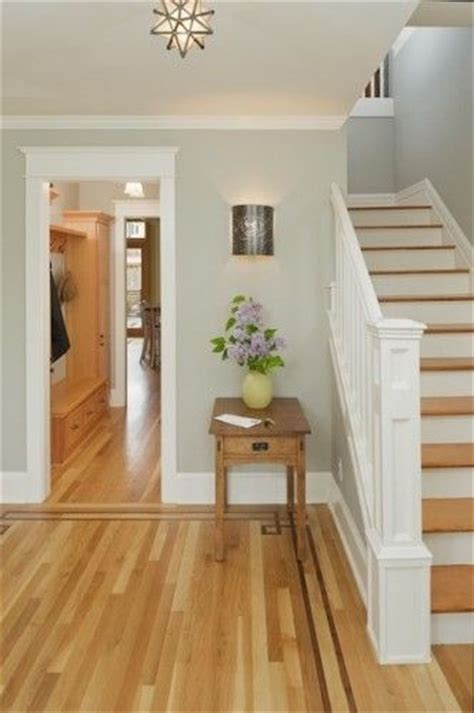 lovely entry with light grey walls white trim medium hardwood home entry office