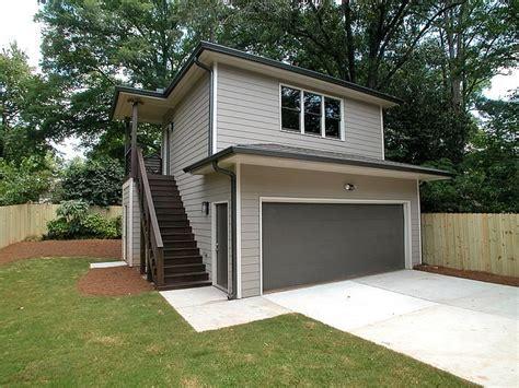 detached garage    modern prairie style home
