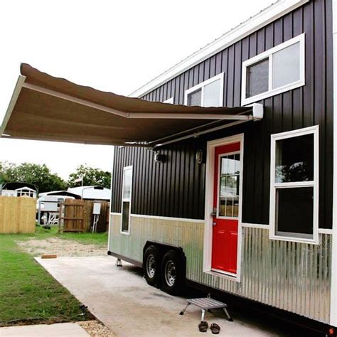 a 192 square tiny house with electric awning built by