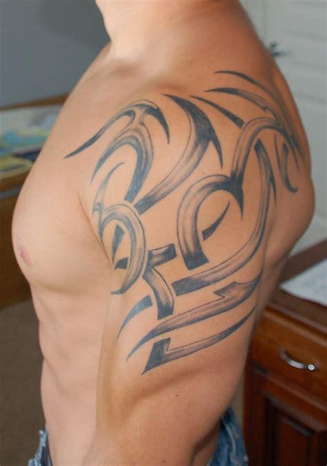 tattoo tribal designs on shoulder shoulder tribal with integrated lettering 1 of 2