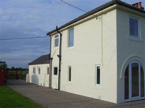 Spray Paint Exterior House - an exterior textured coating on house in cumbria never