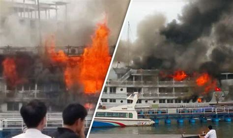 x fire boat tourists jump overboard after cruise ship catches fire