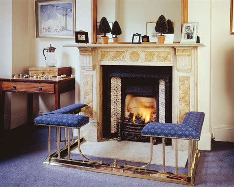 seating in front of fireplace origninal club fender fire fender seats and fireplace