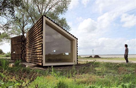 cabin architecture olgga s portable log cabin conceals a sleek modern