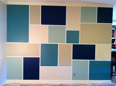 paint design on wall there are more how to paint a tree on feature wall gt step 1 tape out design step 2 paint