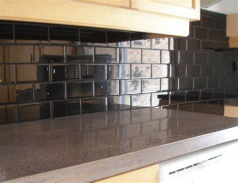 black glass tiles for kitchen backsplashes black subway tile kitchen backsplash for the home ceramics beautiful and we