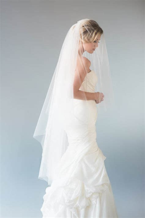ivory tiered elegant fingertipwaltz length tulle wedding