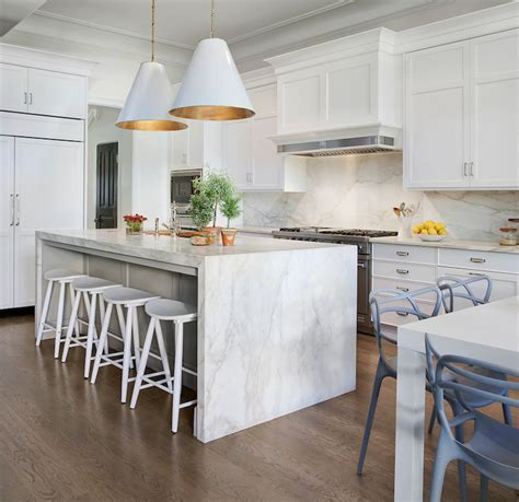 white marble kitchen island marble waterfall island transitional kitchen space