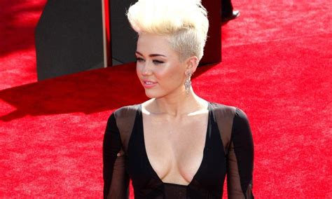 Fame Miley Cyrus miley cyrus seems to be wearing an engagement ring fame