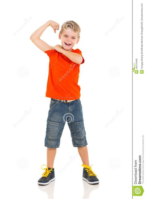 little boy flexing bicep little boy showing off stock photo image of child cutout