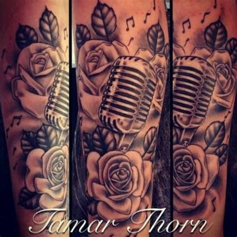 rose and music tattoo like the microphone notes and roses all