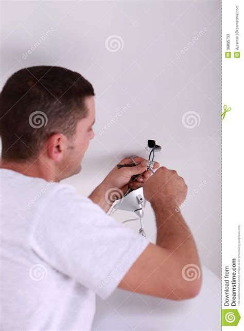 Fixing A Ceiling Light by Fixing Ceiling Light Stock Photos Image 36895733