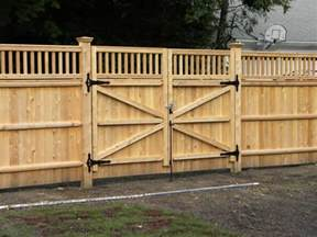 privacy fence driveway gate fence company in ma builds a double drive gate this double drive