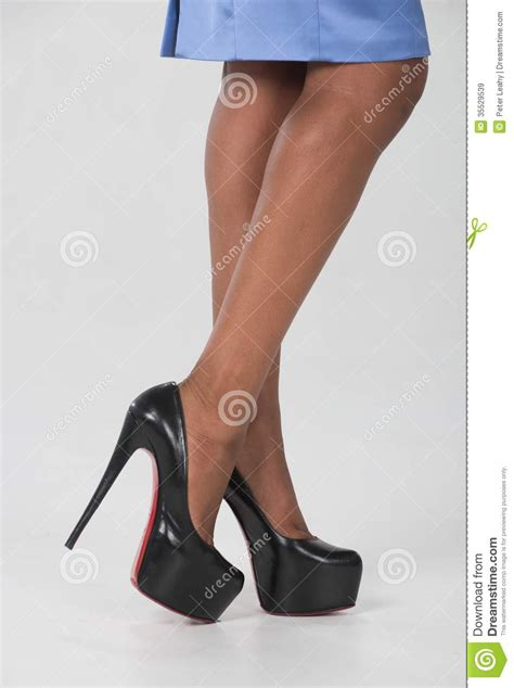 legs and high heeled shoes royalty free stock images