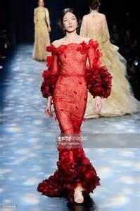 Model walks the runway wearing marchesa fall 2016 during new york