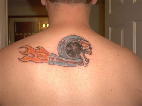 flaming turbo skull tattoo on upperback tattooshunt com