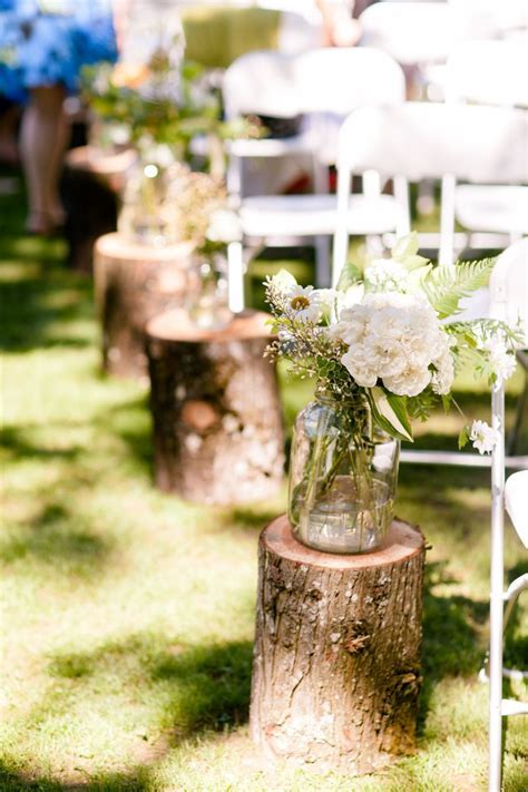 Vintage outdoor wedding isle decorations . The logs and