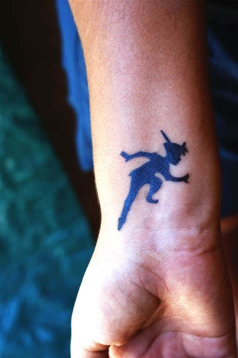 peter pan ear tattoo disney pan silhouette tattoos